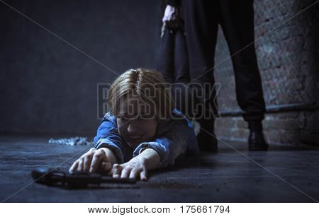 My chance to escape. Trapped disabled furious woman wanting reaching a gun for fighting her abductor while he not letting her taking it