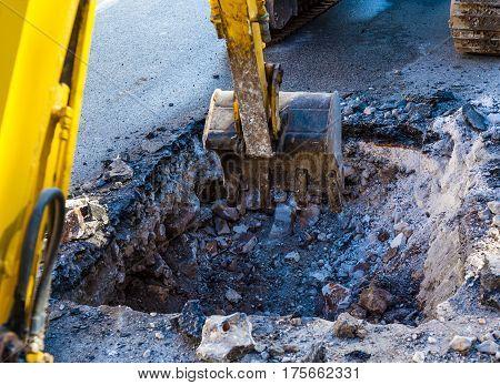 Working Excavator Tractor Digging on street city