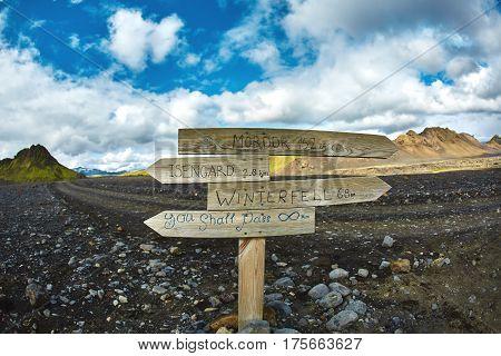pointer against the backdrop of a desert mountain landscape. Treking in National Park Landmannalaugar, Iceland. Travel photography concept