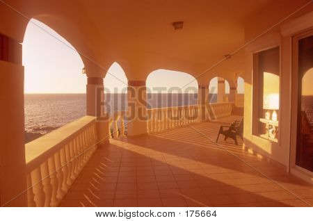 House Deck Lit By Sunset