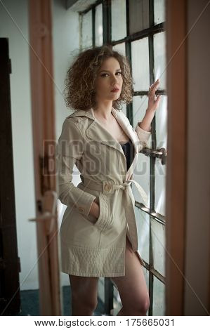 picture of lovely sexy woman. young girl in coat. Fashion woman in coat. Slim young fashion model wearing white coat. portrait of young beautiful fashionable woman