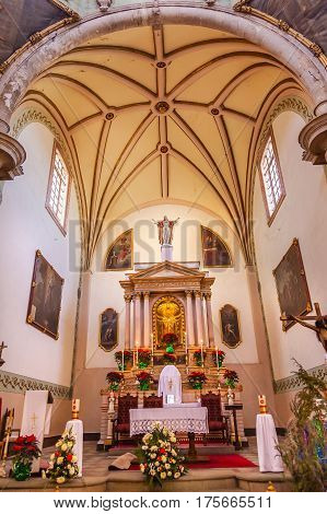 GUANAJUATO, MEXICO - DECEMBER 30, 2014 Basilica Templo De La Compania Christmas Poinsettas Guanajuato Mexico. Built by the Jesuits between 1746 to 1765.