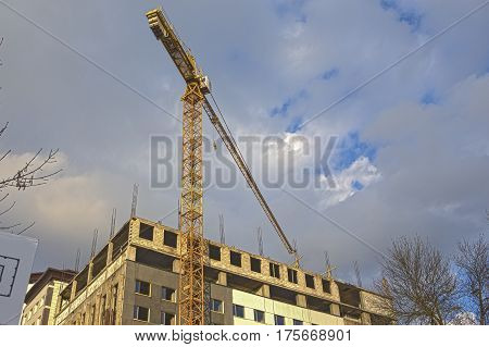 Building and Construction Concepts. Construction Building Site With Industrial Mid-Size Crane. HDR Image Toning. Horizontal Image Composition