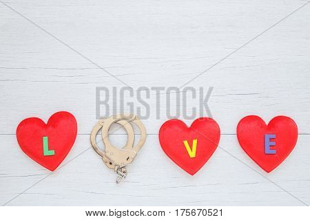 Red Heart Shape With Love Word And O Replace By Shackle On White Wooden Plank Background. For Love O