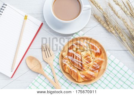 Danish Pastries, Coffee And Note Book On White Wooden Table