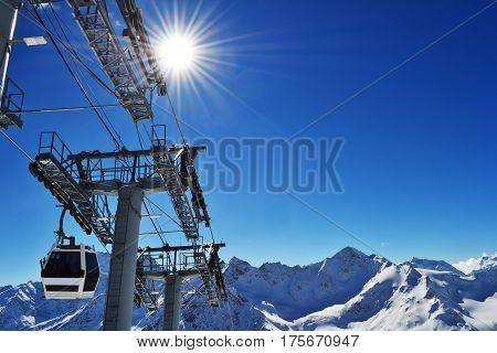 the cabin of the ski lift rises to the peak of the mountains. mountain landscape with ski-lift. photo on the theme of ski resort, winter sports, recreation, travel.