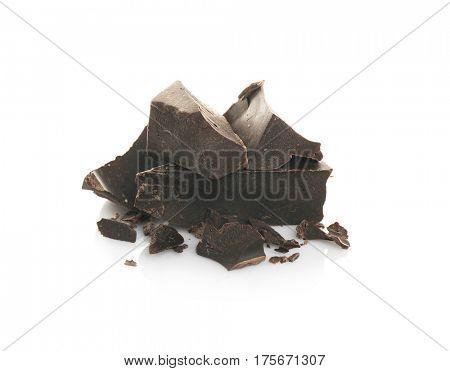 Dark chocolate morsels on white background