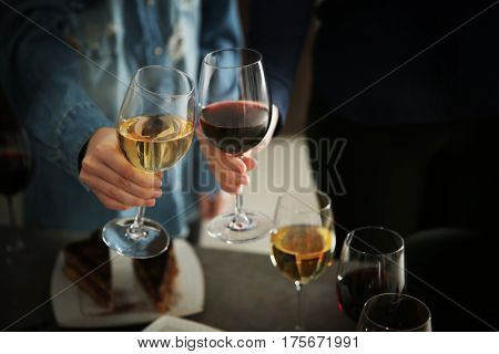 People with wine at party, closeup