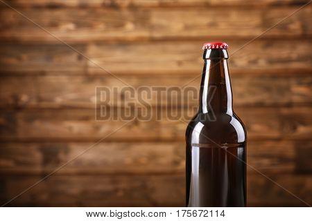 Bottle of beer on wooden background