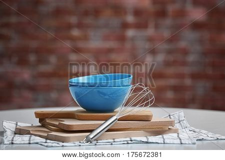Set of kitchen utensils with dishes on table