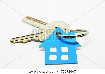 House keys with blue house keychain isolated