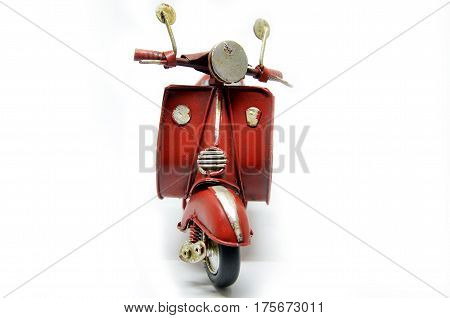 Red old vintage scooter isolated on white