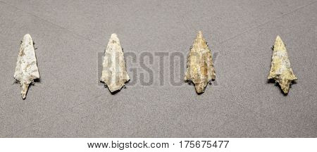 Madrid, Spain - February 24, 2017: neolithic stone arrowheads