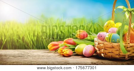 Basket of easter eggs with flowers