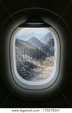 The Window Of Airplane With Travel Destination Attraction. Huangsan Mountain Range, China