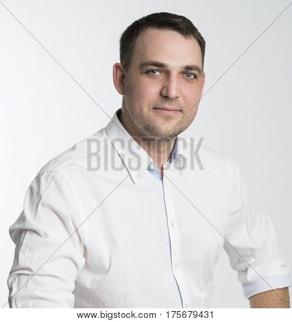 Portrait of a calm businessman in white shirt, isolated on white