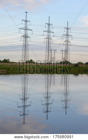 Power line in the countryside at evening on the outskirts of St. Petersburg Russia.