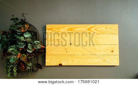 wooden plate on wall and background wood