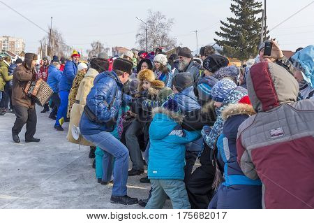 Berdsk Novosibirsk oblast Siberia Russia - February 26 2017: Russian holiday of farewell to winter. Sports contest among children - tug of war