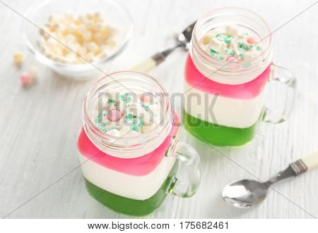 Layered dessert with decoration on wooden table