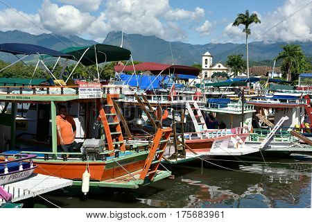 Tourist Boats Waiting For Tourists Near The Church Igreja De Santa Rita De Cassia In Paraty State Ri