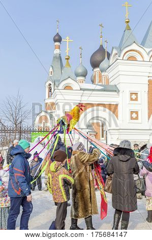 Berdsk Novosibirsk oblast Siberia Russia - February 26 2017: people whirling in the dance in the carnival holiday