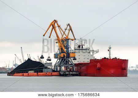 Large Red Cargo Ship Loading