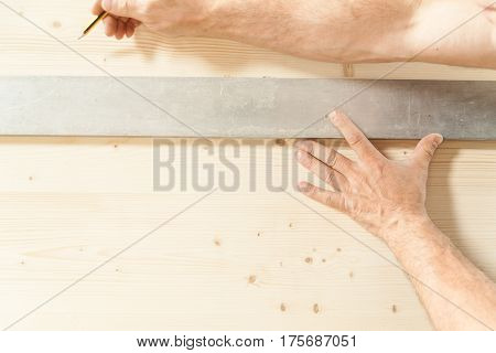 Hands Of A Woodworker In His Carpentry