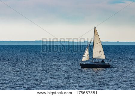 White sailboat traveling in the Baltic sea