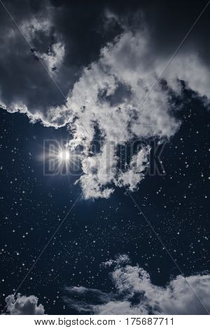 Amazing blue dark night sky with many stars bright full moon and cloudy. Outdoor at nighttime with moonlight. Pretty nature use as background.