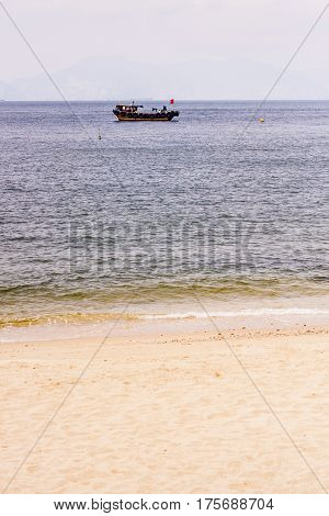 Small Boat And A Beach