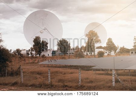 View of a big long range communication antenna and solar panel.
