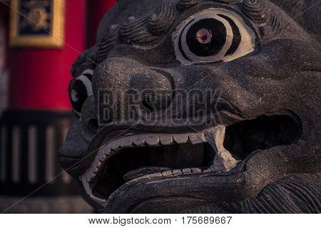 Stone dragon statue at a taoist temple