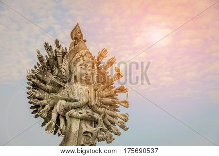 Guan Yin statue with blue sky background