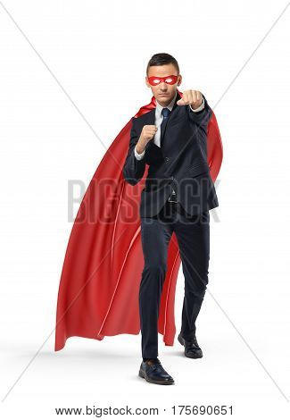 A businessman in a superman red cape and a mask standing in punch position on white background. Business and success. Competition battle. Fighting off adversaries.