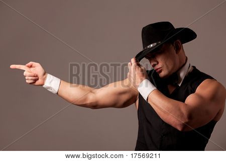 Handsome athletic man aiming with fingers
