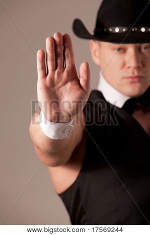 Strong man making inhibit gesture