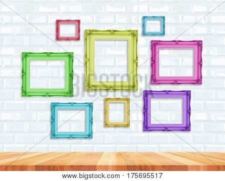 Group Of Colorful Contemporay Victorian Style Vintage Frames On White Tile Wall And Wood Floor,mock