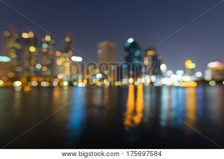 Office building blurred light night view water reflection abstract background