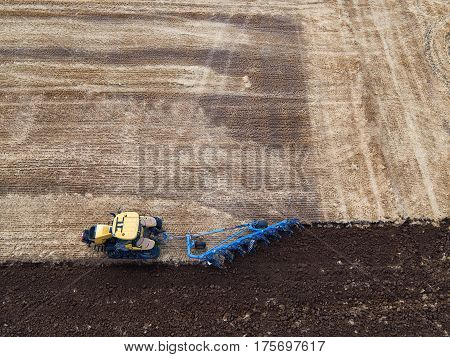 Tractor Cultivating Field At Autumn