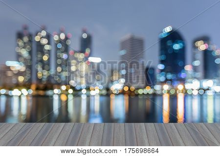 Opening wooden floor Twilight blurred bokeh city office building with reflection abstract background