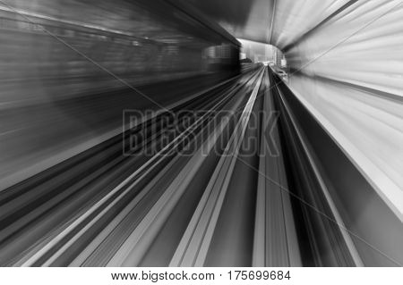 Blur motion subway moving in tunnel abstract background