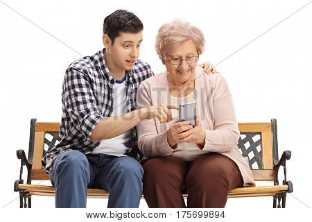 Young man showing an elderly woman how to use a mobile phone isolated on white background