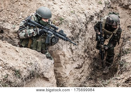 Paratroopers of french 1st Marine Infantry Parachute Regiment RPIMA in entrenchments