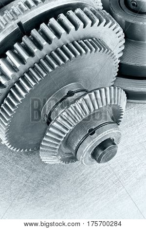 Gear Cogwheels On Scratched Surface. Technology Background.