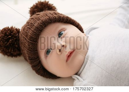 Cute little baby lying in cradle at home, closeup