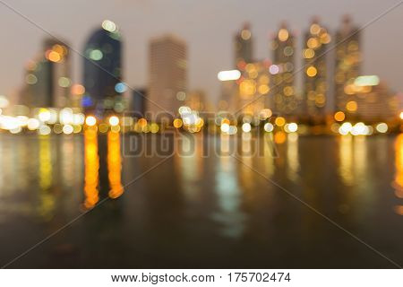 Abstract blurred bokeh city office building and reflection night view