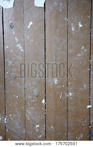 Wood planks with rubish. Close-up vertical photo