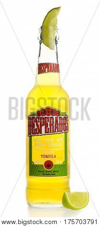 Bottle of Mexican Desperados Tequila beer with lime wedge isolated on a white background