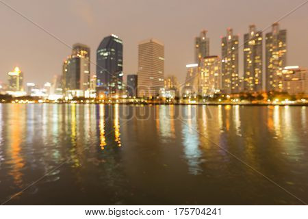 City building blurred light with water reflection night view abstract background